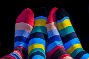 Colored socks on Valentine couple feets