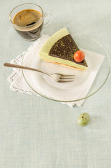 Piece of easter cake with tea matcha decorated chocolate ganache