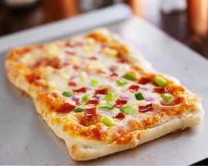 homemade baked pizza on baking sheet