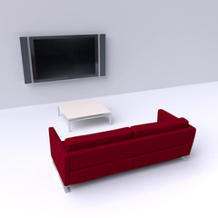 Red sofa with a flat screen TV on the wall