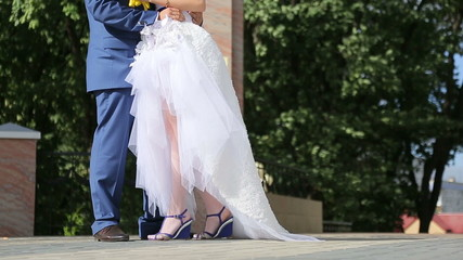 Feet of bride and groom, couple walking in the park