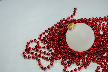 Christmas Holiday Ornaments of white opaque balls and colorful r