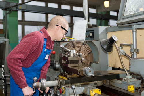 man works for Production Machine - 77567597