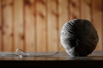 Ball of threads on an old table close up