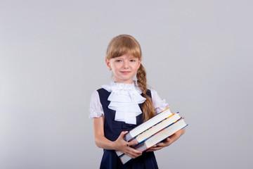 Cute beautiful schoolgirl with books