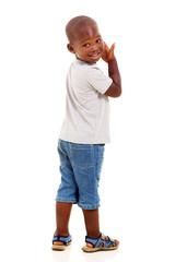 little african american boy looking back