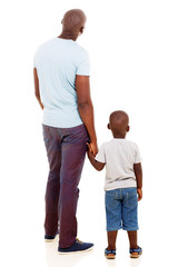 rear view of young african man with his son