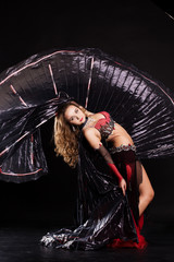 Beautiful belly dancer wearing a black costume