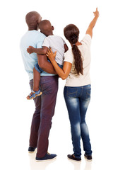afro american young family pointing at empty space
