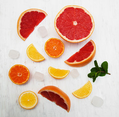 Fresh citrus fruits with ice and green mint