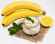 Leinwandbild Motiv Banana with natural yoghurt