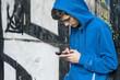 Leinwandbild Motiv urban woman with mobile phone