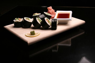 traditional sushi on black background
