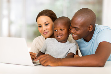 young african american family using laptop