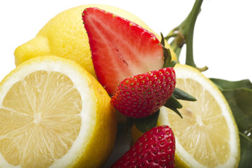 Strawberry with lemon sliced close up on white