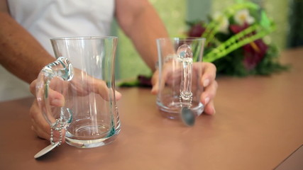 Close up shot of two glasses put on a board