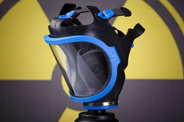 Gas mask on toxic symbol background