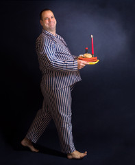 Obese man carries a tray of food