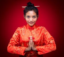 Asian woman greets