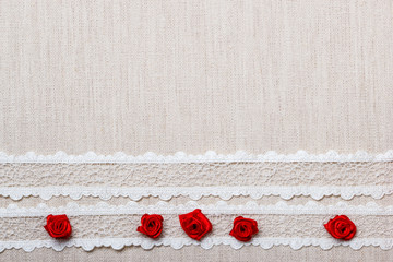Frame of red silk roses on cloth