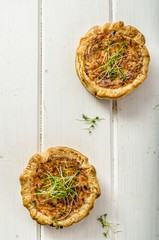 Onion mini quiche with bacon and corn