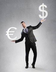 Businessman holding a dollar and euro symbol