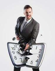 Businessman breaking a clock