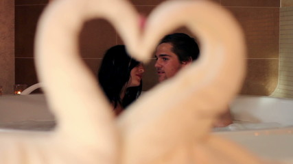 Shot of a couple through a heart made out of towel