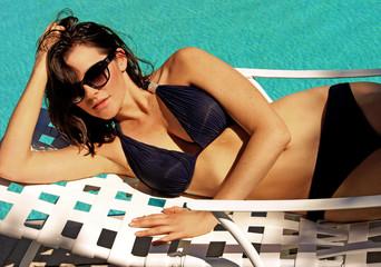 Beautiful woman in bikini swimsuit on the pool in Florida