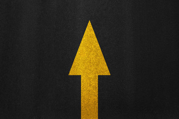 Arrow sign on asphalt
