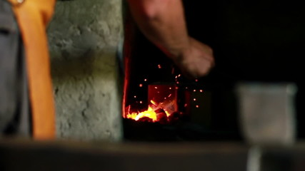 Close up shot of the furnace with fire and sparkling
