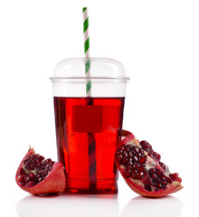 Pomegranate juice in fast food closed cup with tube and slices