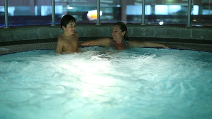 mother and son playing luxury hot tube