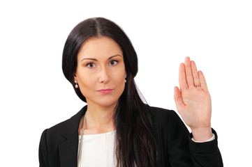 Serious woman makes stop gesture with hand