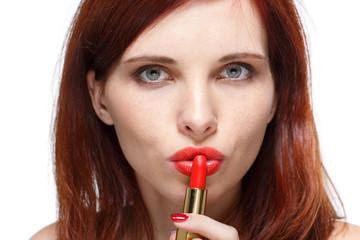 Woman applying lipstick for lips.