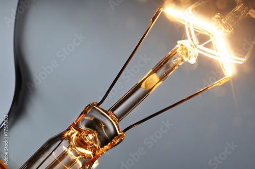 Close up glowing light bulb - 77578132
