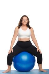 fat woman sitting on blue ball fitness