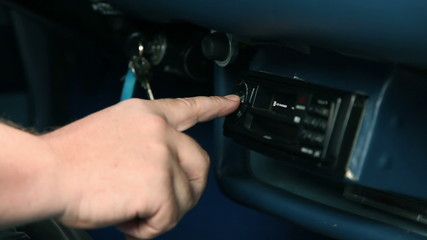 Pressing the button on the radio for changing radio station