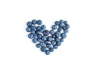 Heart sign made of fresh blueberries on a white background,