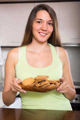 Housewife with cookies in kitchen