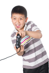 Asian boy with a joystick playing video games, isolated