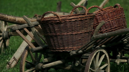 Close up shot of the old wooden cart with the big baskets on it