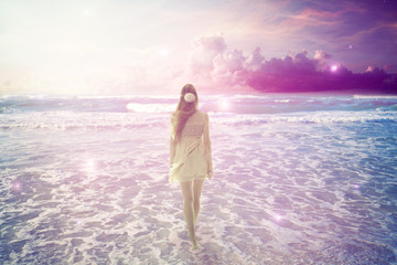 woman walking on dreamy beach enjoying ocean view