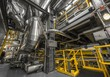 Leinwanddruck Bild - Industrial pipes in a thermal power plant