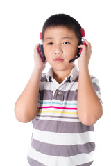Asian boy listening music with headphones, isolated