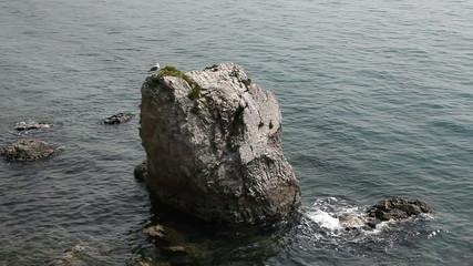 Shot of the big rock in the sea near the coast