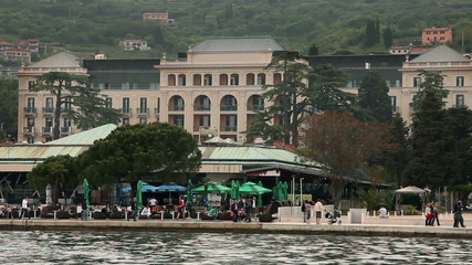 Shot of the restaurand on riviera of Portorose and old hotel in  the back