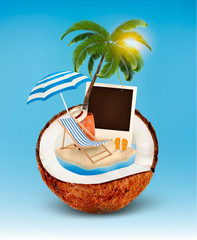 Vacation concept. Palm tree, suitcase and a photo in a coconut.