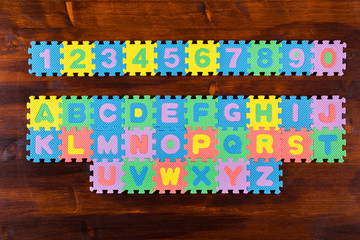 puzzle letters on wooden background