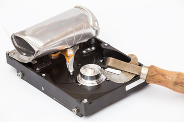 broken hard drive and can opener